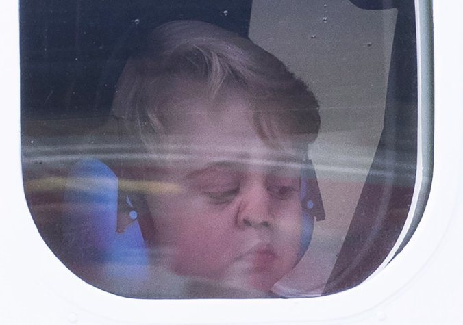 prince-george-face-against-plane-window-canada-pictures